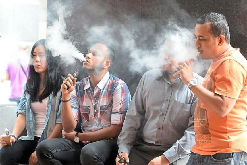 A group of young adults vaping in Malaysia. Many are former smokers.