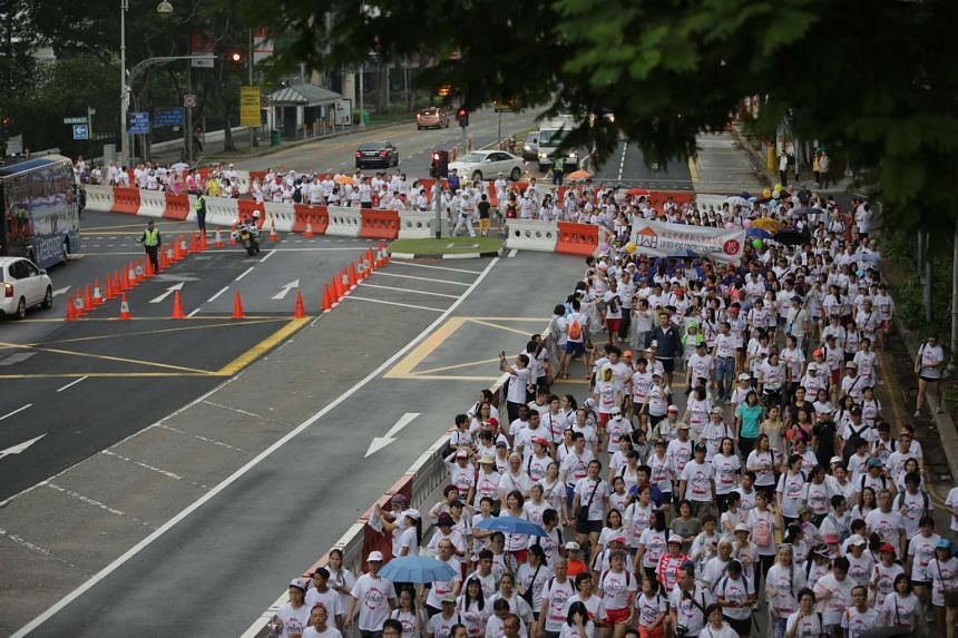 The five-kilometre mass walk, organised by The New Paper and the People's Association, marked the end of the nation's SG50 celebrations.