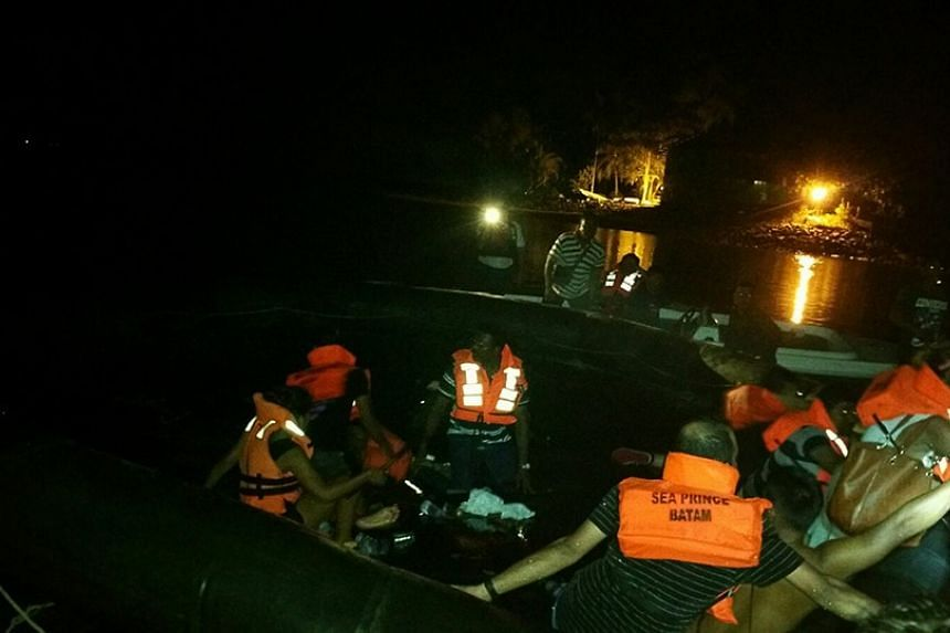 Passengers were travelling on board a ferry to Singapore from Batam when the vessel hit a floating object in the water. Rescue works pictured.