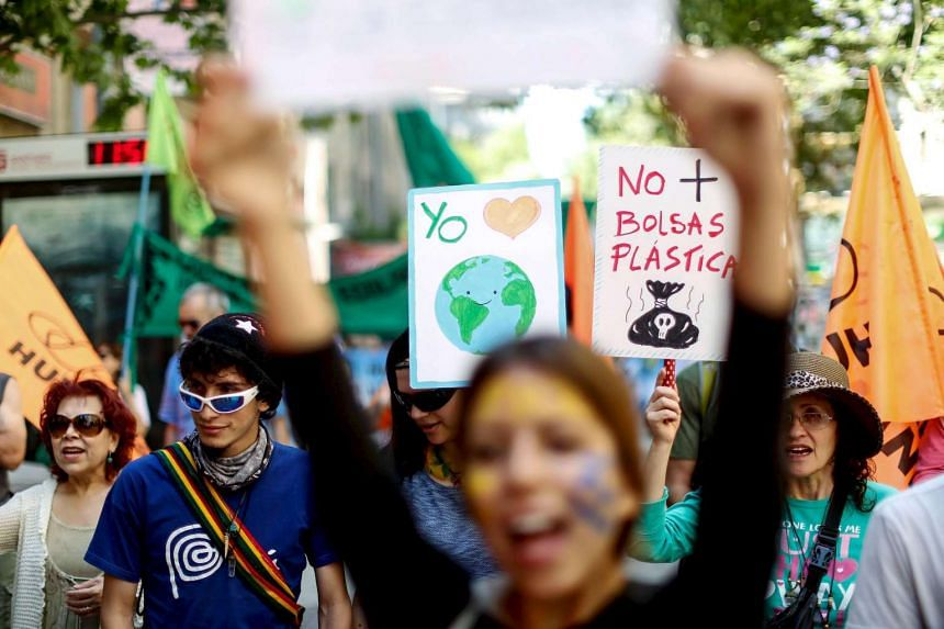 Protesters attend a rally held the day before the start of the Paris Climate Change Conference in Santiago, Chile, on Nov 29, 2015.