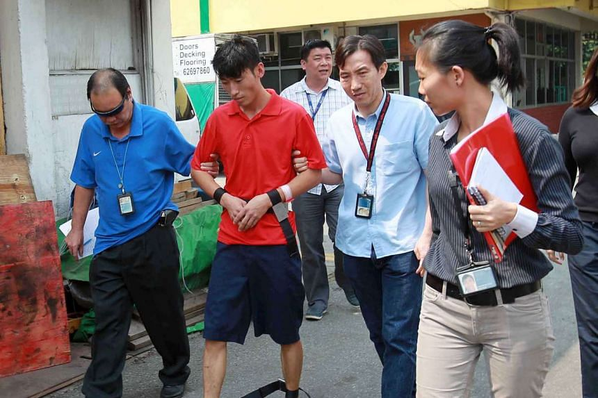 Chinese national Li Yongxiang (in red) at the crime scene on June 24, 2013.