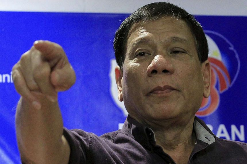 Rodrigo Duterte gestures during a ceremony proclaiming him as a presidential candidate in Manila on Nov 30, 2015.