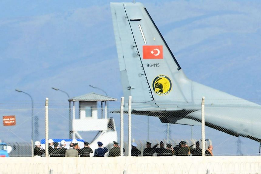 The coffin of the pilot killed when Turkey shot down a Russian jet is carried to a Turkish Air Force Cargo Aircraft on Nov 29, 2015.