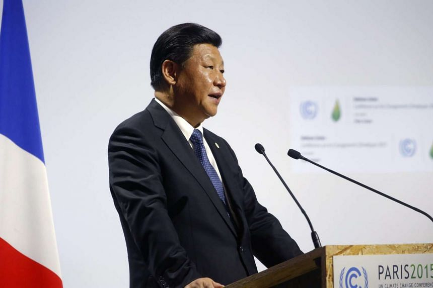 Chinese President Xu Jinping delivers a speech at the World Climate Change Conference on Nov 30, 2015.