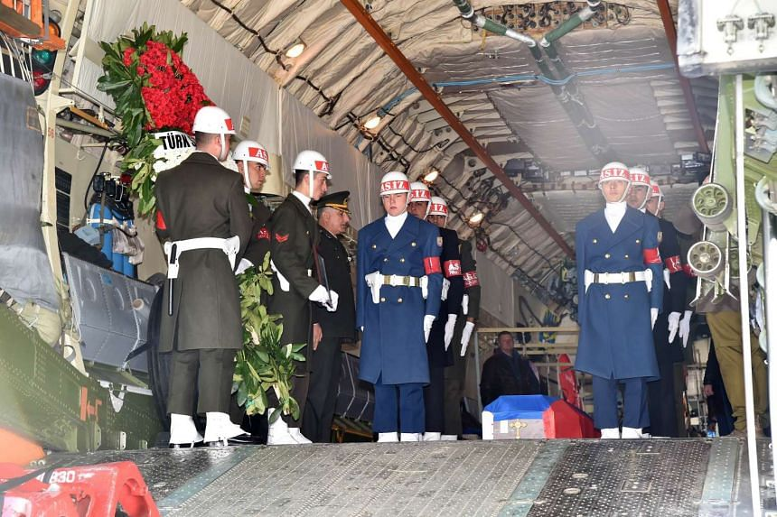 Turkish soldiers about to carry the coffin of Russian pilot Oleg Peshkov on Nov 30, 2015.