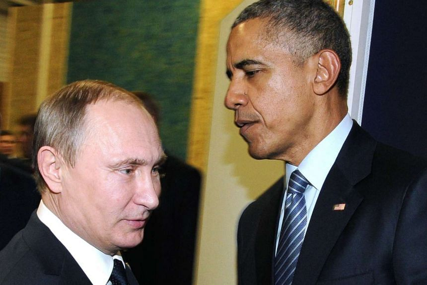 Russian President Vladimir Putin (left) meets with US President Barack Obama on the sidelines of the COP21 conference.