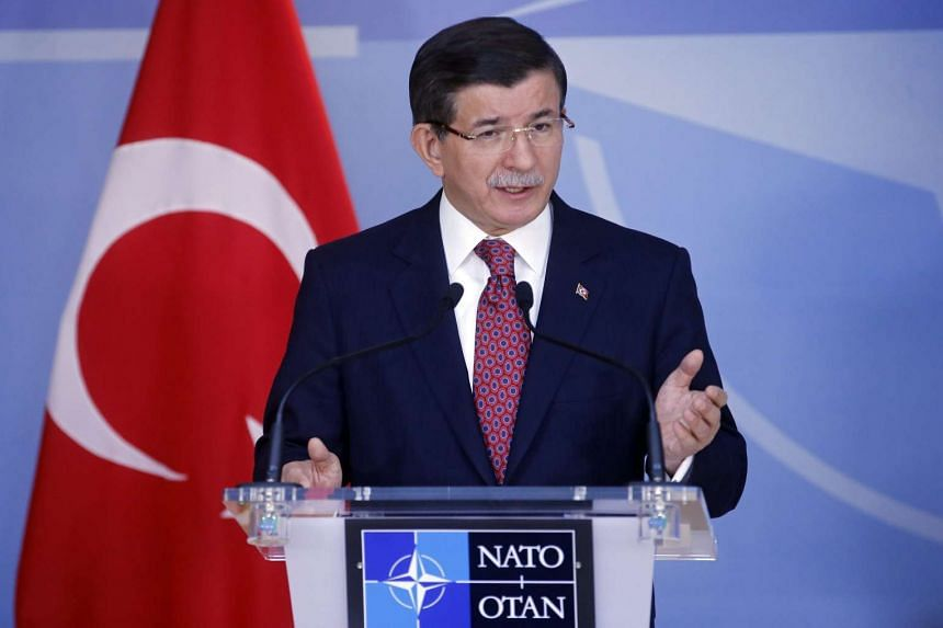 Turkish Prime Minister Ahmet Davutoglu delivering a press briefing after meeting NATO  Secretary General Jens Stoltenberg.