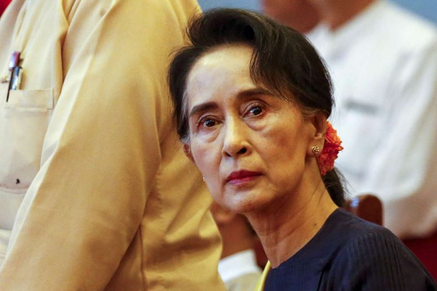 Myanmar pro-democracy leader Aung San Suu Kyi attends a party meeting in Yangon on Nov 28, 2015.