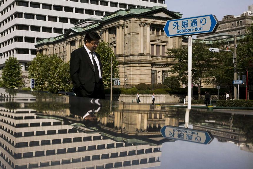 A man walks past the Bank of Japan (BOJ) building in Tokyo.