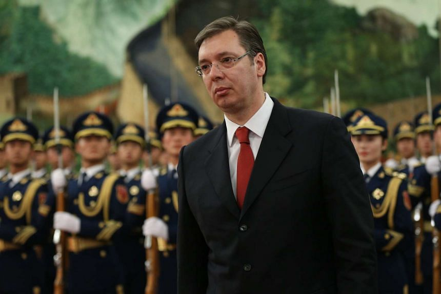 Serbian Premier Aleksandar Vucic walks past People's Liberation Army honor guards during a welcome ceremony at the Great Hall of the People in Beijing, China, on Nov 26, 2015.