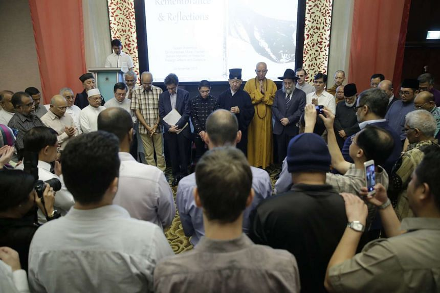 Leaders and representatives from all major faiths in Singapore congregate for a silent prayer during A Gathering of Remembrance and Reflections on Nov 29, 2015.
