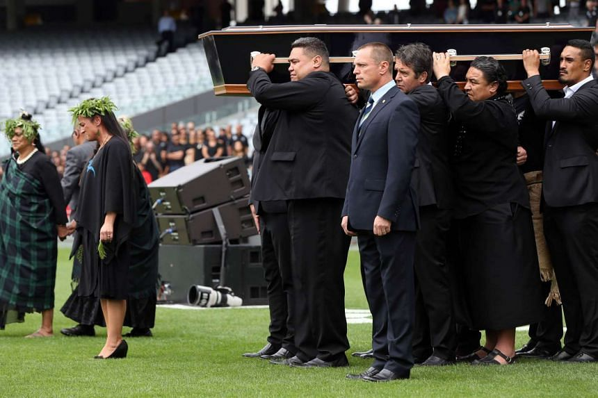 The casket of New Zealand All Blacks rugby legend Jonah Lomu is carried onto Eden Park for a memorial service.