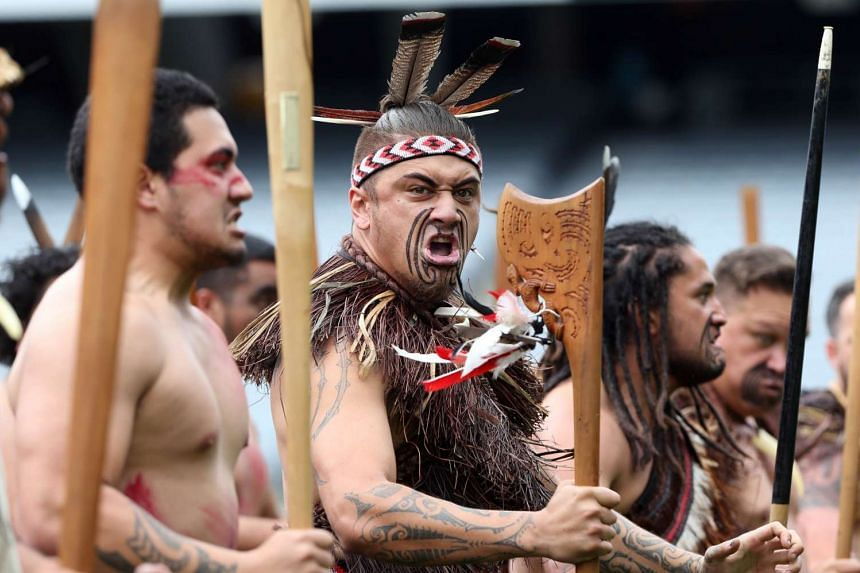 Maori men perform a haka as the casket of New Zealand All Blacks rugby legend Jonah Lomu is carried onto Eden Park during a memorial service.