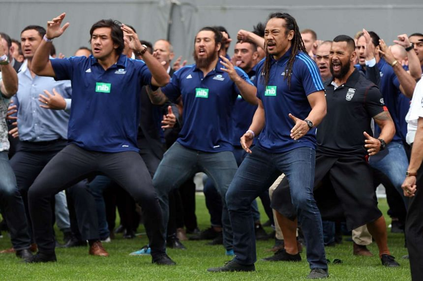 Former rugby players including Tana Umaga (front right) perform a haka during a memorial service for the late New Zealand All Blacks rugby legend Jonah Lomu.