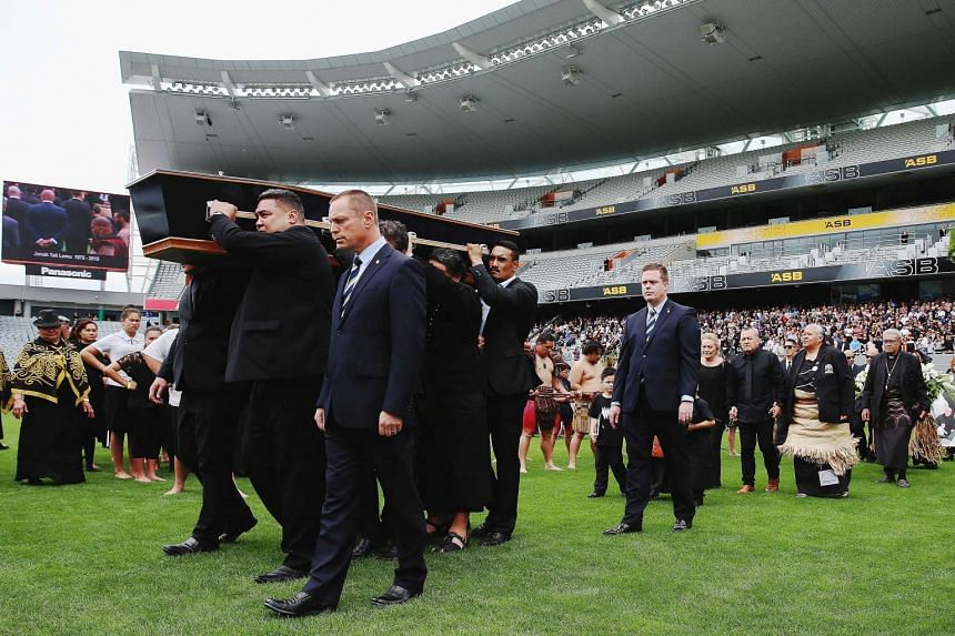 The casket of New Zealand All Blacks rugby legend Jonah Lomu is carried onto New Zealand's home of rugby at Eden Park for a memorial service.
