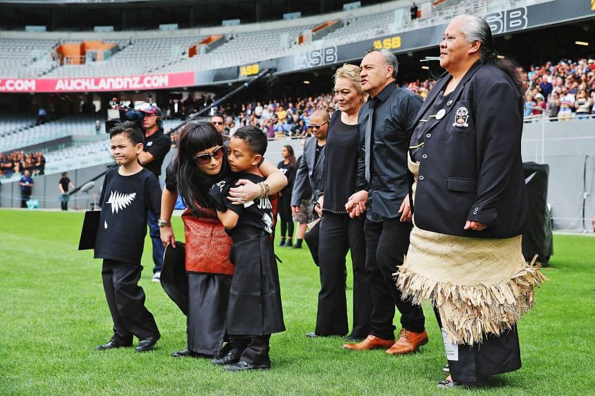 Nadene Lomu (second left), widow of New Zealand All Blacks rugby legend Jonah Lomu, walks onto Eden Park with her two sons Brayley (left) and Dhyreille (third left).