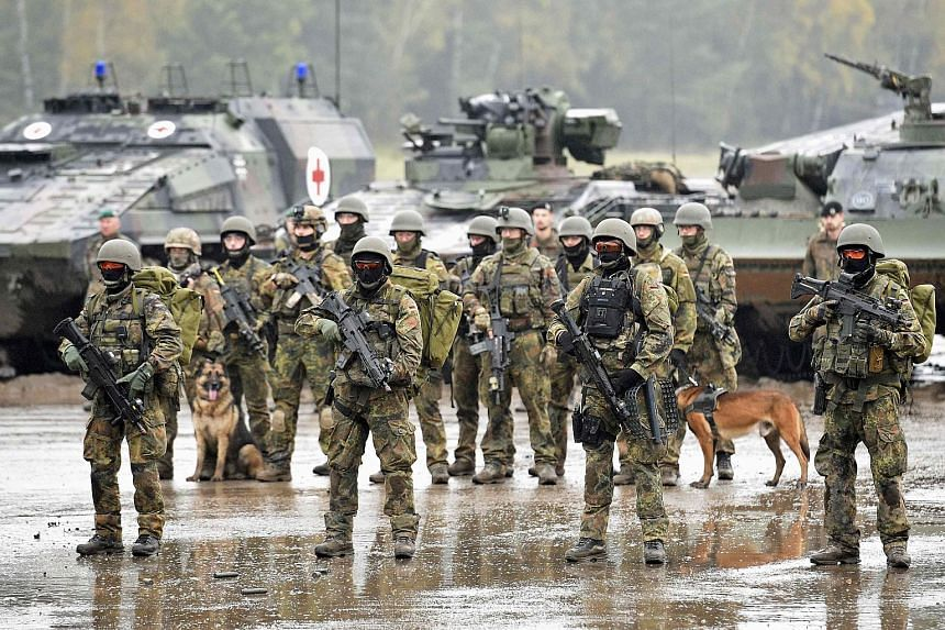 Soldiers holding their weapons during a German army, the Bundeswehr, training and information day in Munster, Germany on Oct 9, 2015.