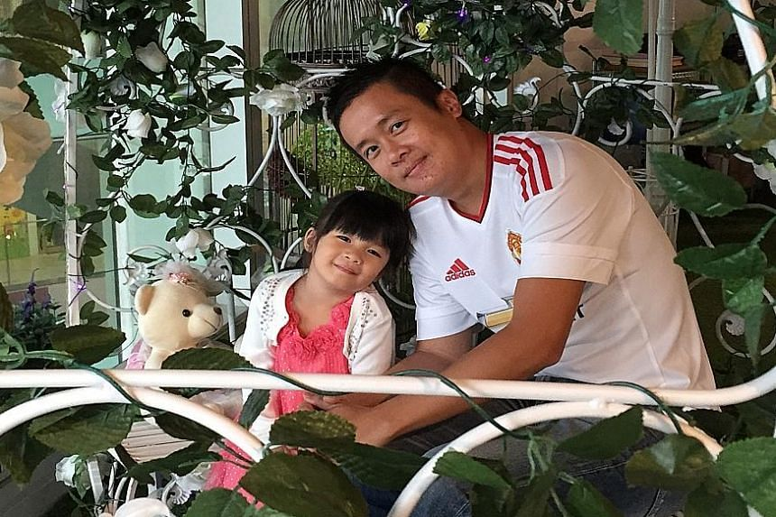 Mr Jag Kuo with his daughter Hazel. Mr Kuo is a lifelong fan of Manchester United Football Club. He writes to the Forum page on issues such as local politics, government policies and finance.