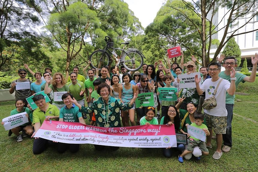 Some of the green campaigners who gathered at Highgate Condominium yesterday who pledged to reduce their carbon footprint.