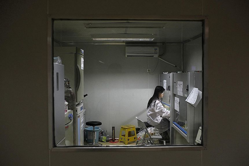 A researcher preparing medicine at a laboratory in China, the world's second-biggest drugs market behind the United States. A global powerhouse in other high-tech areas, it is now rising to the challenge of making more of its own drugs for a vast and