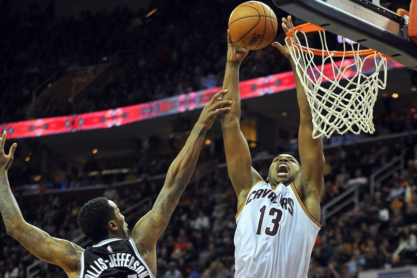 Cleveland centre Tristan Thompson making an alley-oop basket over Brooklyn guard Rondae Hollis-Jefferson in the fourth quarter to make it 86-85 yesterday. In the end, it came down to LeBron James' runner in the lane with one second left for Cleveland