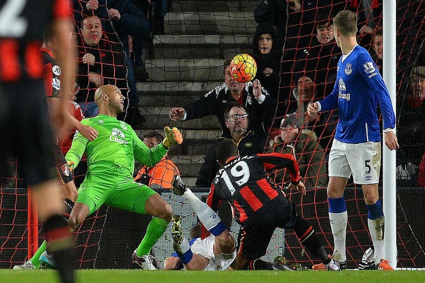 Everton goalkeeper Tim Howard could only watch in vain, as Bournemouth midfielder Junior Stanislas (right) scores his team's second goal in the thrilling 3-3 draw.