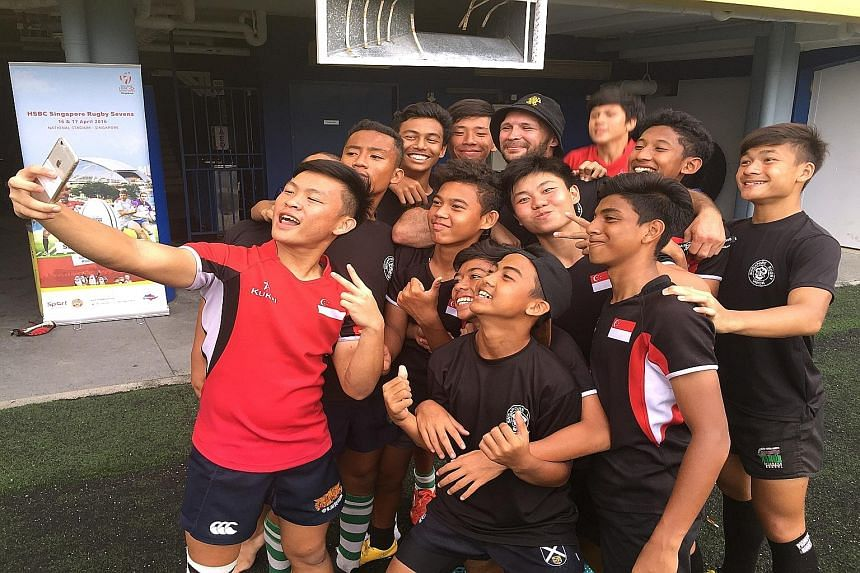 Schoolboy rugby players with former All Black Scott Waldrom (in hat) at the Heroes in the Making training camp yesterday.