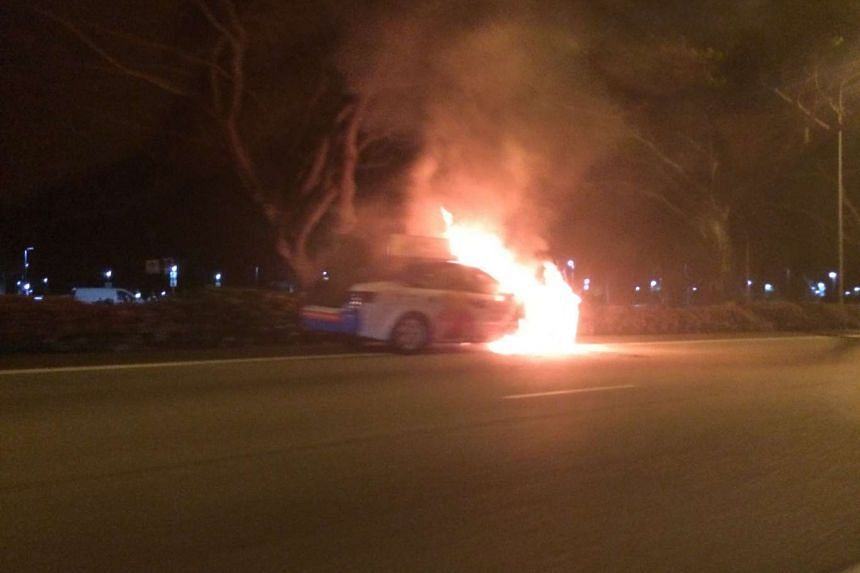 The cab on fire along the East Coast Parkway on Nov 29, 2015.