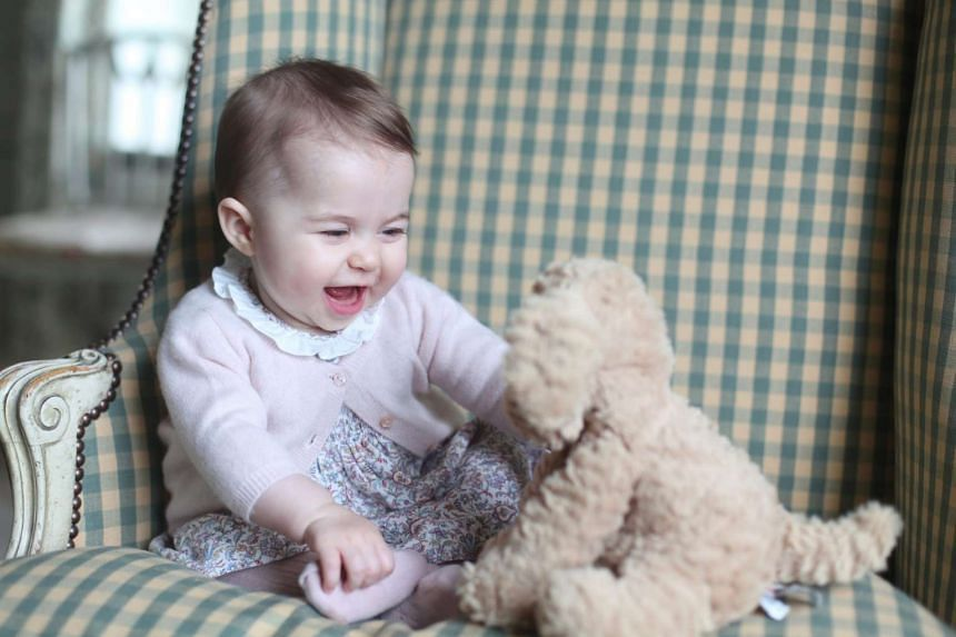 An undated handout photo released on Sunday showing Princess Charlotte with her toy dog at Anmer Hall in Sandingham, Norfolk.