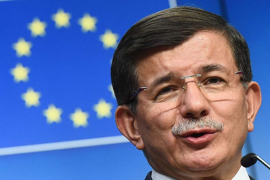 Turkish Prime Minister Ahmet Davutoglu holds a press conference in Brussels Sunday.