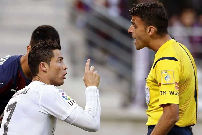 Real Madrid's Cristiano Ronaldo (left) argues with referee Jesus Gil Manzano during a match against Eibar on Sunday.