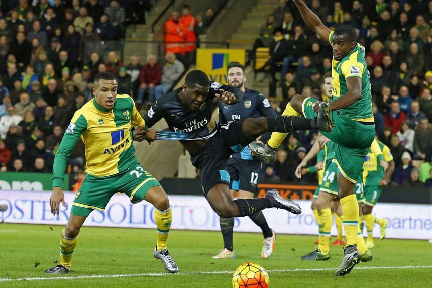 Arsenal's Costa Rican striker Joel Campbell (second left) vies with Norwich City's Martin Olsson (left) and Sebastien Bassong on Sunday.