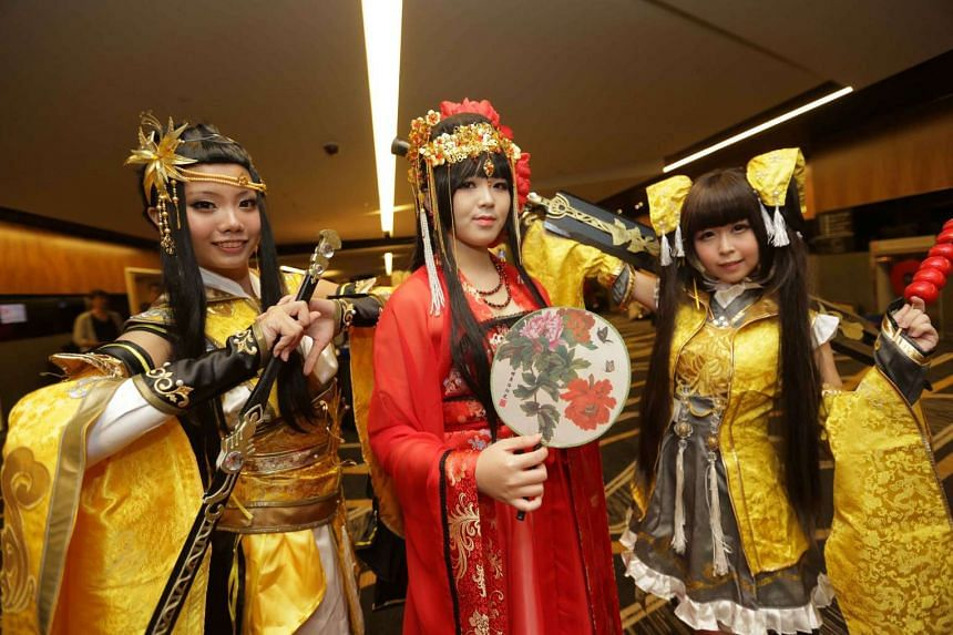 Polytechnic student Dion Tan (left) and undergraduate Jolene Chan (right) appeared as characters from Legend Of The Swordman Online III, an online Chinese game, complete with swords made of wood and foam, while polytechnic student Xia Ming (centre) w