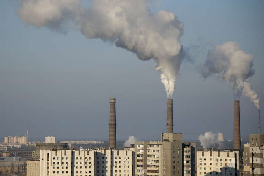 Smoke from pipes of an electricity generating plant rises over apartment buildings in Kiev, Ukraine.