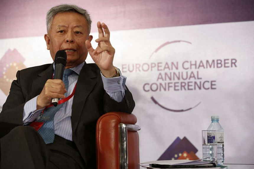 Jin Liqun gestures during a panel session of the European Chamber Annual Conference.