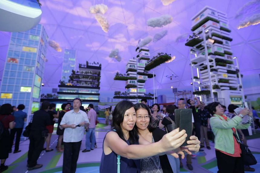 Visitors taking a selfie in one of the exhibition domes part of the Future of Us exhibition.