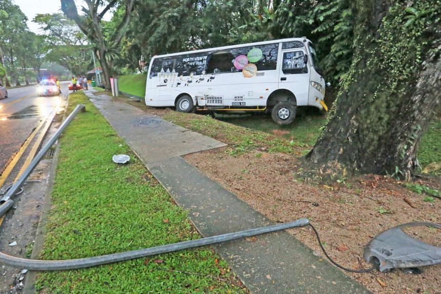 A minibus hit a lamp post and landed in drain at Lentor Ave on Nov 30, 2015.