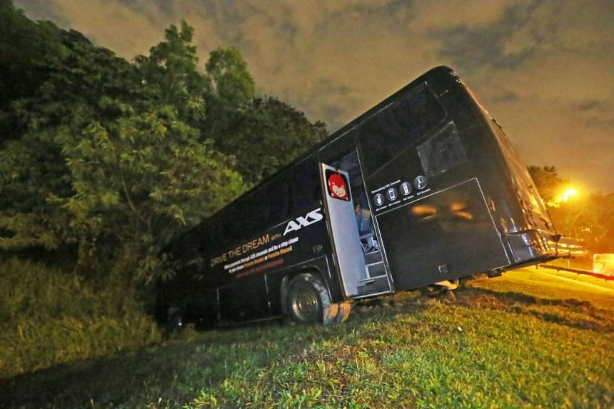 A private bus carrying 40 foreign workers drove into a drain, narrowly missing a tree on Nov 30, 2015.