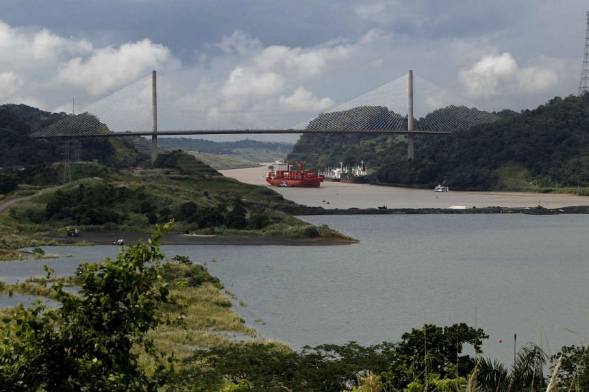 A cargo boat navigates on the Panama Canal next to the expansion project of the Panama Canal on the pacific side in Panama City, on Nov 17, 2015.