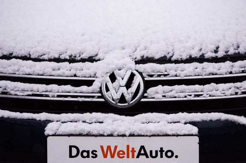A snow-covered front of a Volkswagen Tiguan with the plate 'the world car' can be seen in at a car dealership in Luebeck, Germany, on Nov 22, 2015. Volkswagen is filing the first suggestions for dealing with the emissions scandal in the USA shortly b
