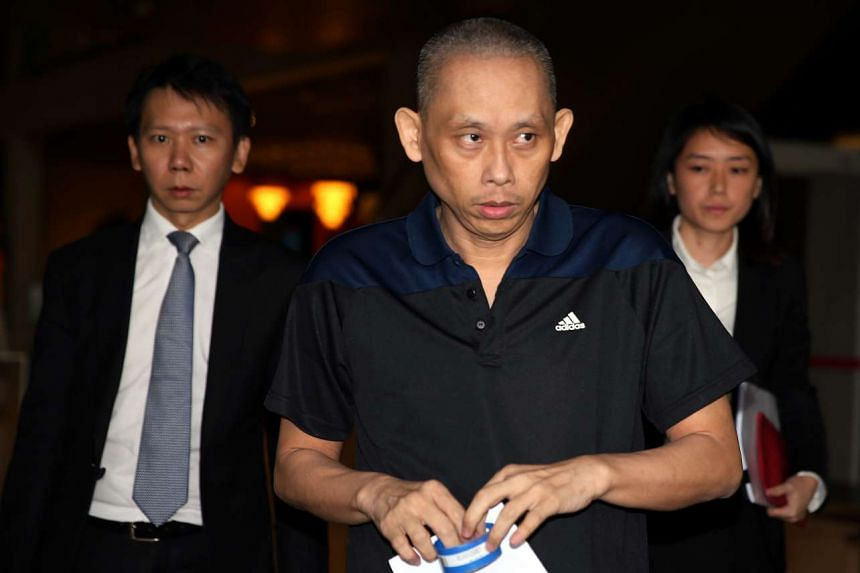 Dan Tan (centre) leaving the Supreme Court on Nov 25, 2015.