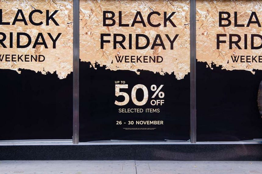 """Retail stores display """"Black Friday"""" advertisements and banners on Oxford Street in central London, as the annual retail event takes place on Nov 27, 2015."""