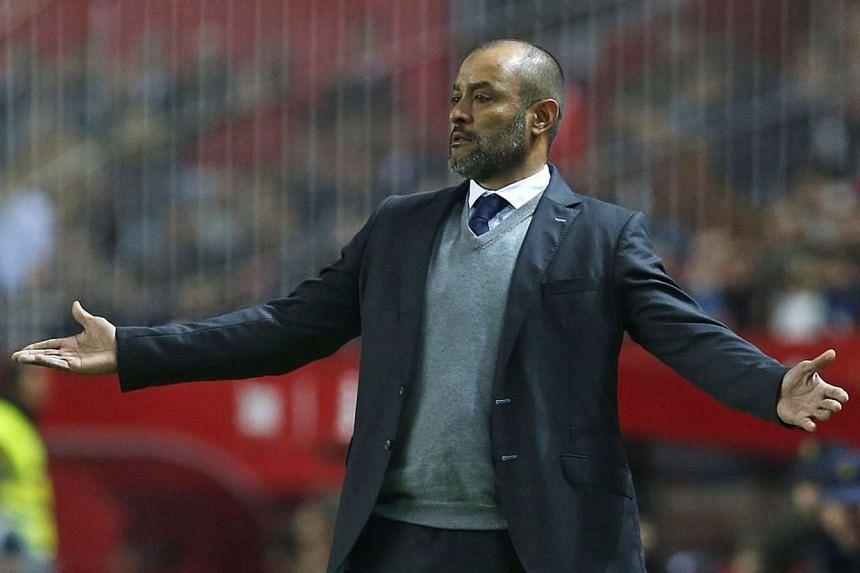 Valencia's Portuguese coach Nuno Espirito Santo reacts during the Spanish Primera Division soccer match played against Sevilla at Sanchez Pizjuan stadium in Seville, Spain, on Nov 29, 2015.