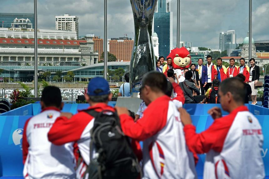 Athletes and delegates from the various Asean countries posing for pictures after the welcome ceremony.