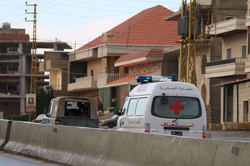 A Lebanese Red Cross ambulance carries the body of a Lebanese soldier executed last year by Al-Qaeda's Syrian affiliate Al-Nustra Front on Dec 1, 2015.