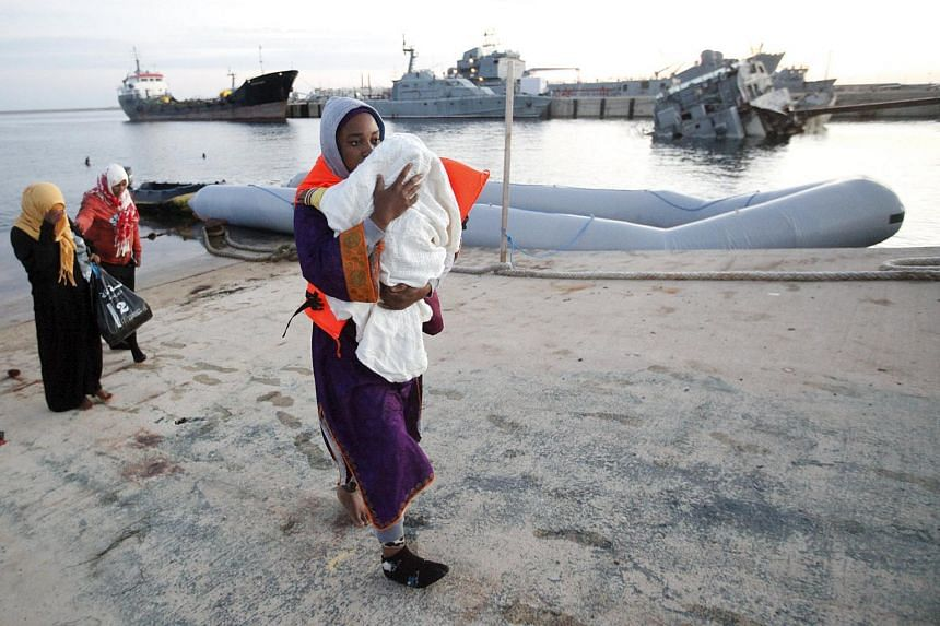 Would-be migrants disembark a Libyan Navy boat in Tripoli on Sept 29. The North African country has turned into a major hub for human traffickers.