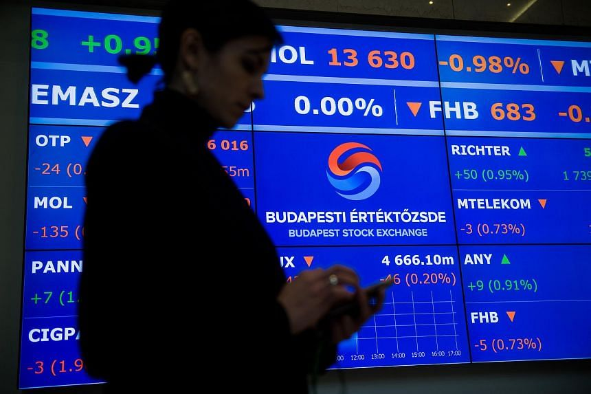 A woman browsing her mobile phone at the Budapest Stock Exchange on Nov 24.