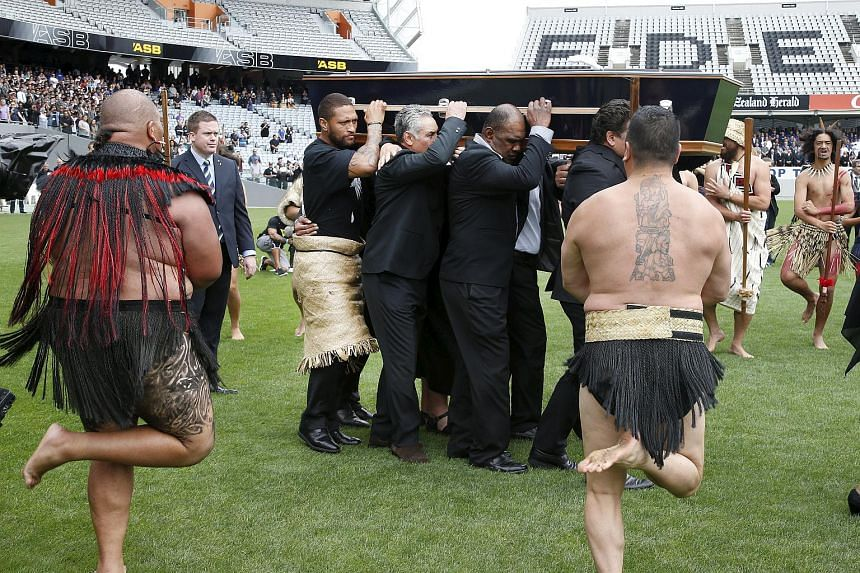 Former All Black Jonah Lomu's casket being carried onto Eden Park for his memorial service.