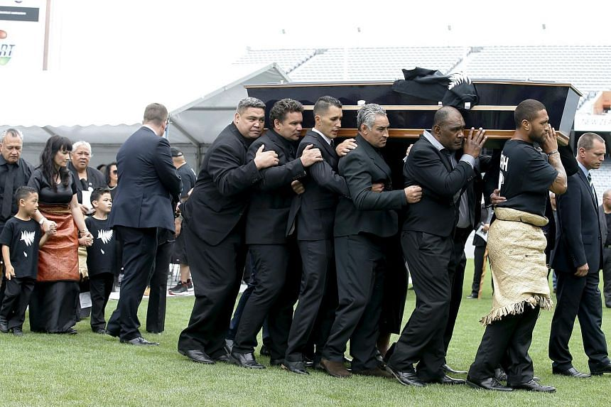 The casket of late New Zealand All Blacks rugby legend Jonah Lomu being carried out of Eden Park.