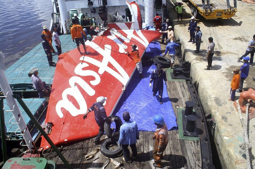 A section of AirAsia Flight QZ8501's tail loaded onto a boat for transportation to Jakarta from Kumai Port on Feb 7, 2015.